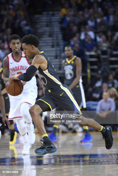 Patrick McCaw of the Golden State Warriors dribbles the ball against the Phoenix Suns during an NBA basketball game at ORACLE Arena on February 12...