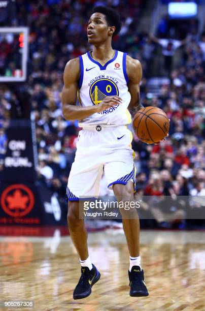 Patrick McCaw of the Golden State Warriors dribbles the ball during the second half of an NBA game against the Toronto Raptors at Air Canada Centre...