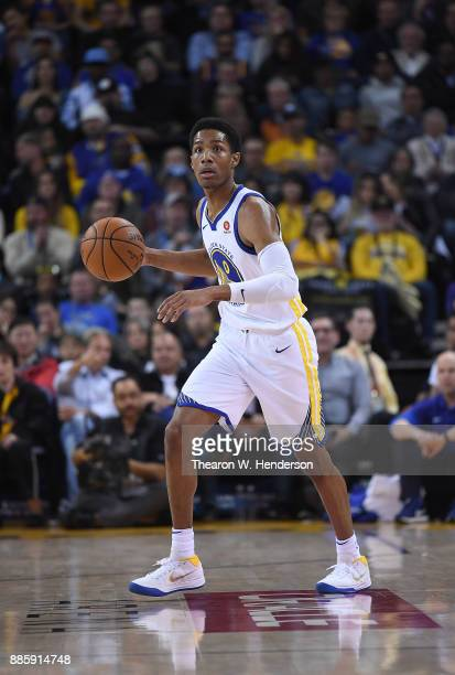 Patrick McCaw of the Golden State Warriors dribbles the ball up court against the Sacramento Kings during their NBA basketball game at ORACLE Arena...