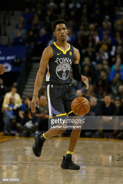 Patrick McCaw of the Golden State Warriors dribbles the ball up court against the Denver Nuggets at ORACLE Arena on December 23 2017 in Oakland...