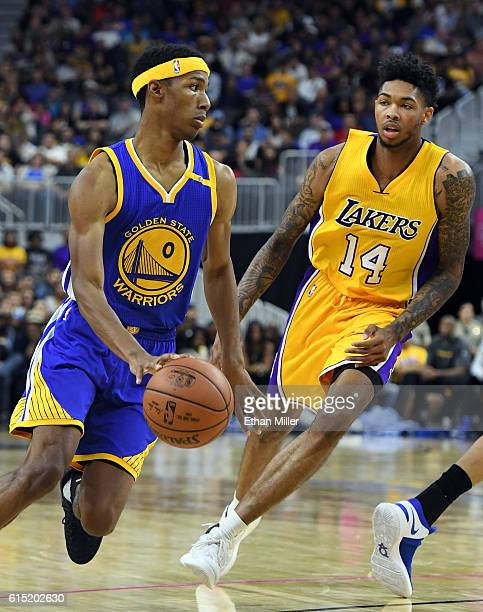 Patrick McCaw of the Golden State Warriors dries against Brandon Ingram of the Los Angeles Lakers during their preseason game at TMobile Arena on...