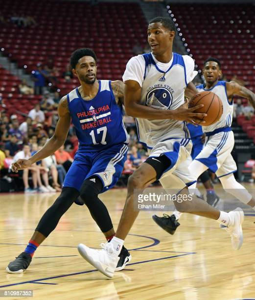 Patrick McCaw of the Golden State Warriors drives to the basket against Larry Drew II of the Philadelphia 76ers during the 2017 Summer League at the...