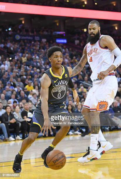 Patrick McCaw of the Golden State Warriors drives to the basket on Tyson Chandler of the Phoenix Suns during an NBA basketball game at ORACLE Arena...