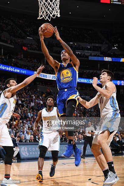 Patrick McCaw of the Golden State Warriors goes to the basket against the Denver Nuggets on November 10 2016 at the Pepsi Center in Denver Colorado...