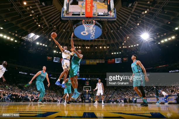 Patrick McCaw of the Golden State Warriors goes to the basket against the Charlotte Hornets on December 29 2017 at ORACLE Arena in Oakland California...