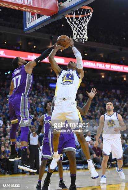 Patrick McCaw of the Golden State Warriors goes up to shoot over Garrett Temple of the Sacramento Kings during their NBA basketball game at ORACLE...