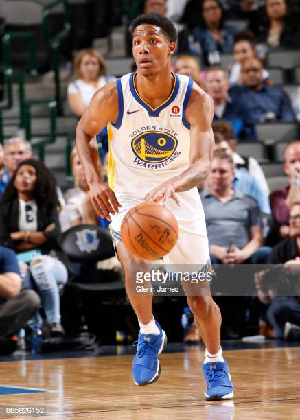 Patrick McCaw of the Golden State Warriors handles the ball against the Dallas Mavericks on October 23 2017 at the American Airlines Center in Dallas...
