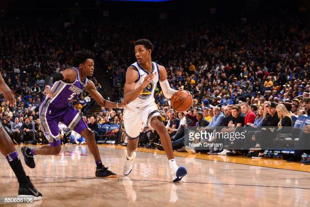 Patrick McCaw of the Golden State Warriors handles the ball against the Sacramento Kings on November 27 2017 at ORACLE Arena in Oakland California...