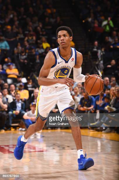 Patrick McCaw of the Golden State Warriors handles the ball against the Dallas Mavericks on December 14 2017 at ORACLE Arena in Oakland California...
