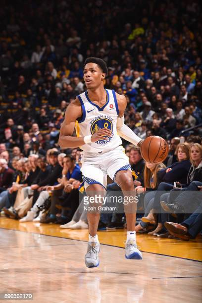Patrick McCaw of the Golden State Warriors handles the ball against the Memphis Grizzlies on December 20 2017 at ORACLE Arena in Oakland California...