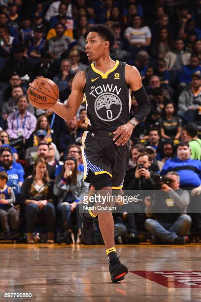 Patrick McCaw of the Golden State Warriors handles the ball against the Denver Nuggets on December 23 2017 at ORACLE Arena in Oakland California NOTE...