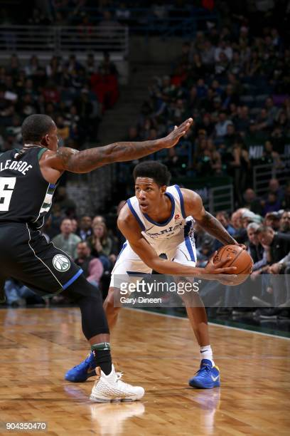 Patrick McCaw of the Golden State Warriors handles the ball against the Milwaukee Bucks on January 12 2018 at the BMO Harris Bradley Center in...