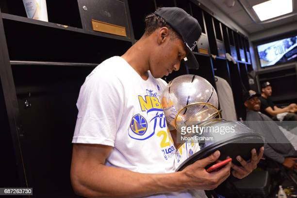 Patrick McCaw of the Golden State Warriors holds the Western Conference Championship Trophy after winning Game Four of the Western Conference Finals...
