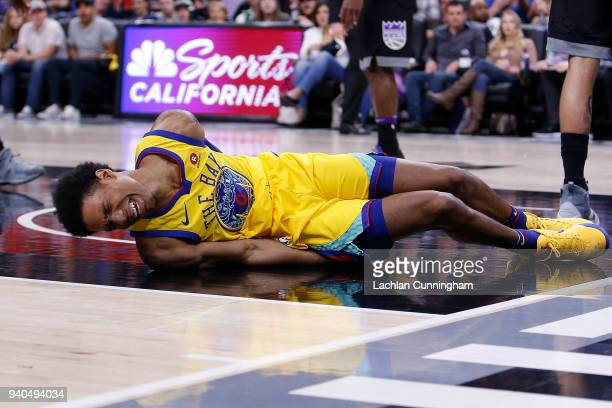 Patrick McCaw of the Golden State Warriors lands heavily after being fouled by Vince Carter of the Sacramento Kings at Golden 1 Center on March 31...