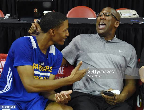 Patrick McCaw of the Golden State Warriors laughs with associate head coach Mike Brown of the Warriors after the team defeated the Minnesota...