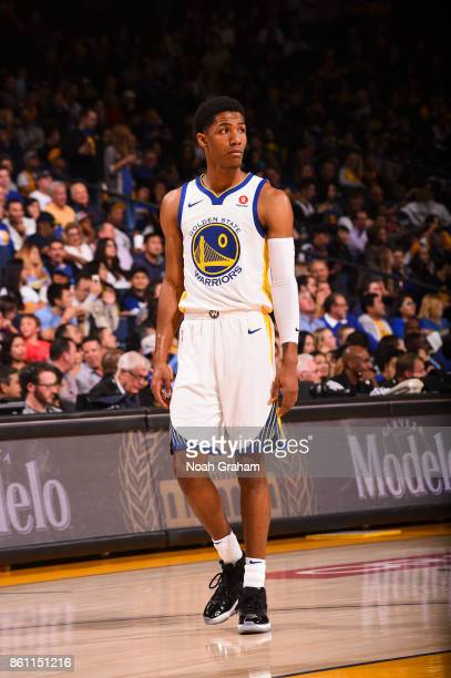 Patrick McCaw of the Golden State Warriors looks on during preseason game against the Sacramento Kings on October 13 2017 at ORACLE Arena in Oakland...