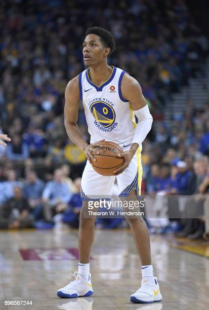 Patrick McCaw of the Golden State Warriors looks to pass the ball against the Portland Trail Blazers during an NBA basketball game at ORACLE Arena on...