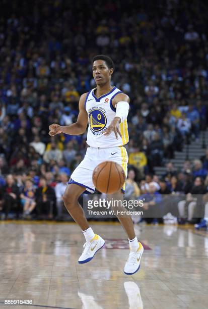 Patrick McCaw of the Golden State Warriors passes the ball against the Sacramento Kings during their NBA basketball game at ORACLE Arena on November...
