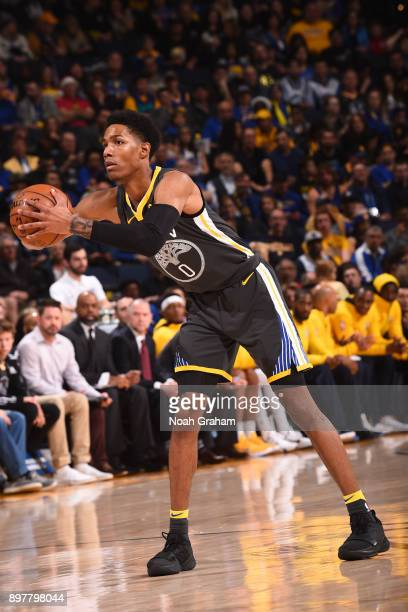 Patrick McCaw of the Golden State Warriors passes the ball against the Denver Nuggets on December 23 2017 at ORACLE Arena in Oakland California NOTE...