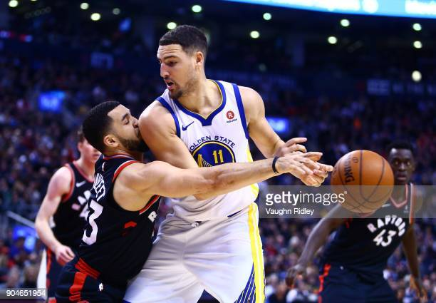 Patrick McCaw of the Golden State Warriors passes the ball as Jonas Valanciunas of the Toronto Raptors defends during the second half of an NBA game...