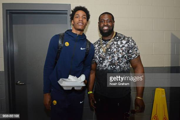 Patrick McCaw of the Golden State Warriors poses for a photo with Clive Walford prior to Game Four of the Western Conference Semifinals of the 2018...
