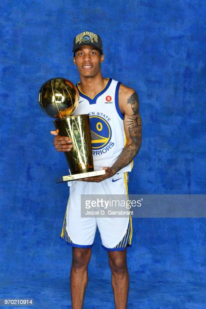 Patrick McCaw of the Golden State Warriors poses for a portrait with the Larry O'Brien Championship trophy after defeating the Cleveland Cavaliers in...