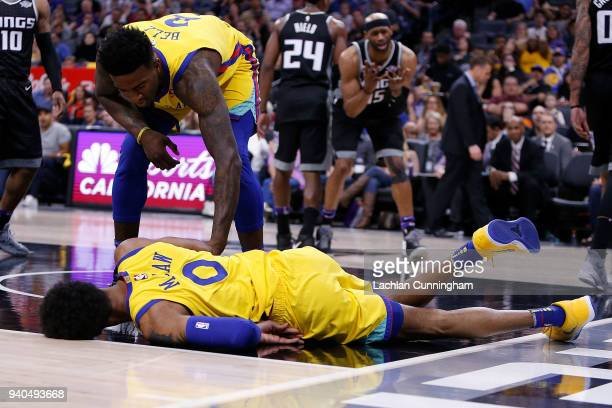 Patrick McCaw of the Golden State Warriors rolls on the floor injured after being fouled by Vince Carter of the Sacramento Kings at Golden 1 Center...