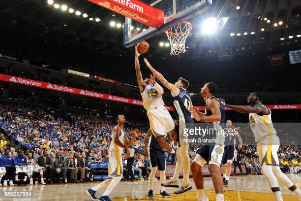 Patrick McCaw of the Golden State Warriors shoots a lay up during the game against the Denver Nuggets during a preseason game on September 30 2017 at...