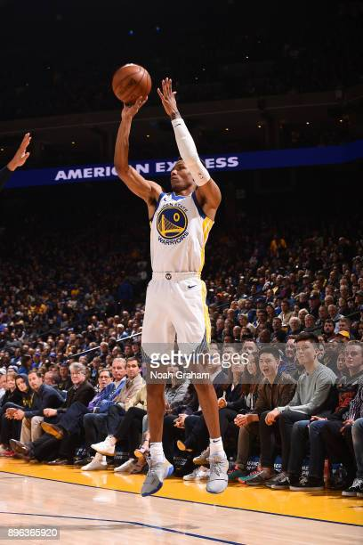 Patrick McCaw of the Golden State Warriors shoots the ball against the Memphis Grizzlies on December 20 2017 at ORACLE Arena in Oakland California...