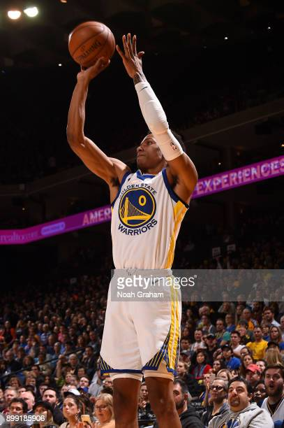Patrick McCaw of the Golden State Warriors shoots the ball against the Utah Jazz on December 27 2017 at ORACLE Arena in Oakland California NOTE TO...