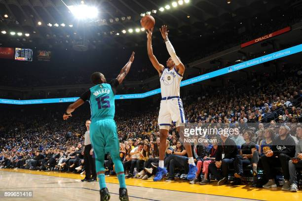 Patrick McCaw of the Golden State Warriors shoots the ball against the Charlotte Hornets on December 29 2017 at ORACLE Arena in Oakland California...