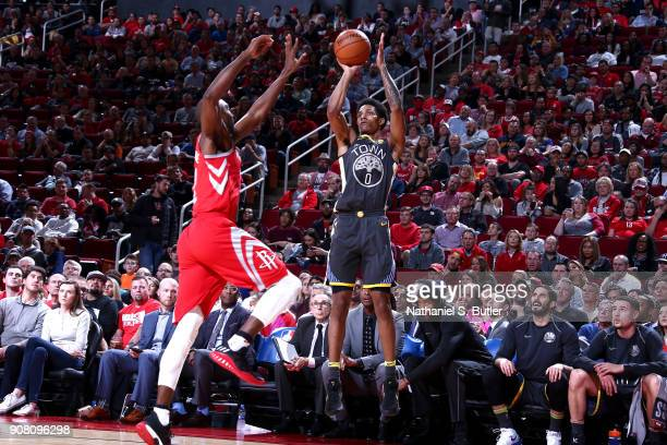 Patrick McCaw of the Golden State Warriors shoots the ball against the Houston Rockets on January 20 2018 at the Toyota Center in Houston Texas NOTE...