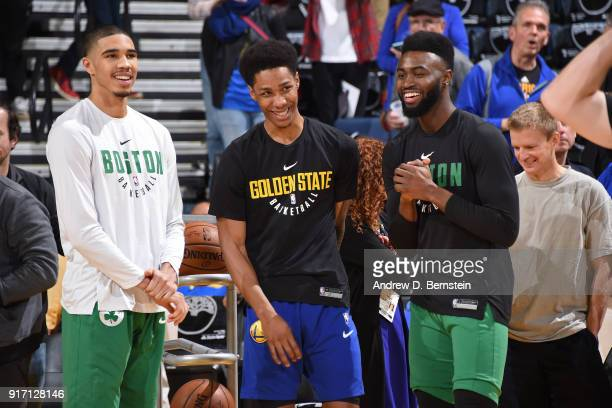 Patrick McCaw of the Golden State Warriors speaks to Jaylen Brown of the Boston Celtics and Jayson Tatum of the Boston Celtics before the game againt...