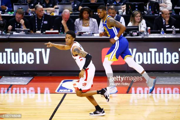 Patrick McCaw of the Toronto Raptors celebrates a basket against the Golden State Warriors in the second half during Game One of the 2019 NBA Finals...