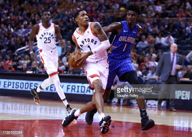 Patrick McCaw of the Toronto Raptors dribbles the ball as Jonathan Isaac of the Orlando Magic defends during the second half of an NBA game at...