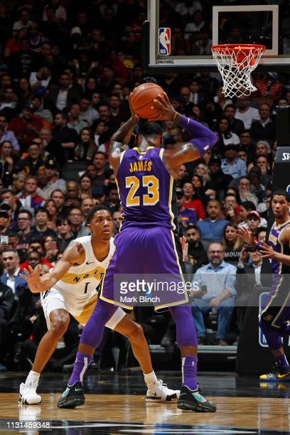 Patrick McCaw of the Toronto Raptors plays defense against LeBron James of the Los Angeles Lakers on March 14 2019 at the Scotiabank Arena in Toronto...