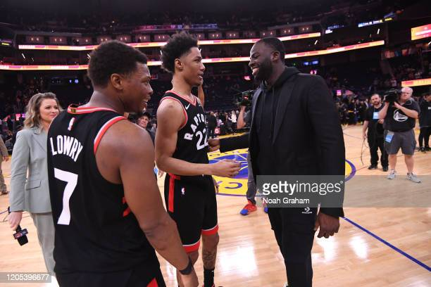 Patrick McCaw of the Toronto Raptors talks with Draymond Green of the Golden State Warriors after the game on March 5 2020 at Chase Center in San...