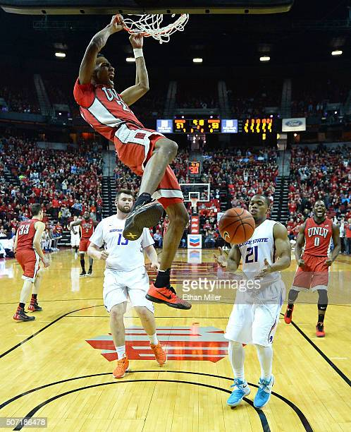 Patrick McCaw of the UNLV Rebels dunks in front of Nick Duncan and Montigo Alford of the Boise State Broncos during their game at the Thomas Mack...