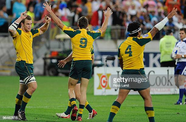 Patrick McCeheon Clinton Sills and Brian Sefanai of Australia celebrat their win in the plate final match between South Africa and Australia during...