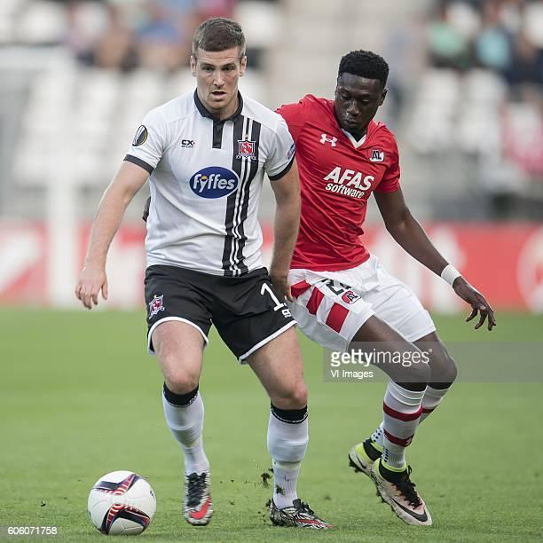 Patrick McEleney of Dundalk FC Derrick Luckassen of AZ Alkmaar during the UEFA Europa League group D match between AZ Alkmaar and Dundalk FC on...