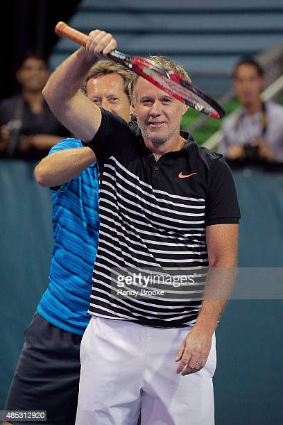 Patrick McEnroe gets a back rub from doubles partner Jonas Bjorkman during their Johnny Mac Tennis Project 2015 Benefit Match at Randall's Island on...
