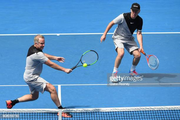 Patrick McEnroe of the United States and John McEnroe of the United States compete in their legend's match against Mansour Bahrami of France and...