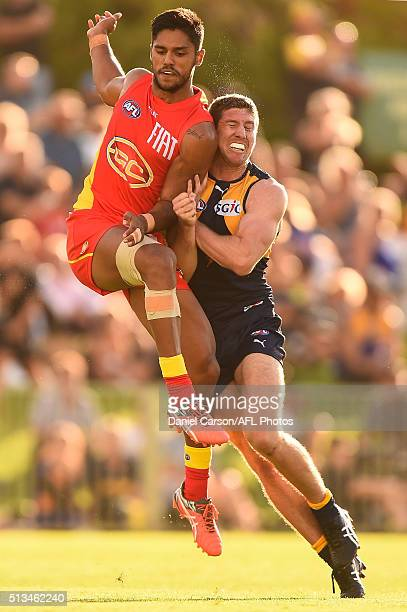 Patrick McGinnity of the Eagles bumps Aaron Hall of the Suns during the 2016 NAB Challenge match between the West Coast Eagles and the Gold Coast...