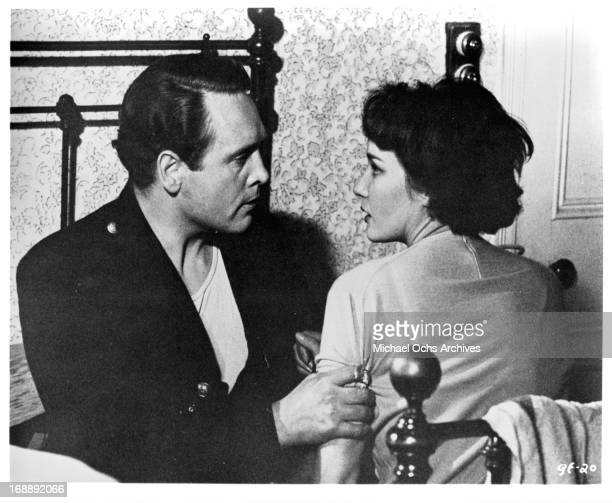 Patrick McGoohan holds Sylvia Syms in a scene from the film 'The Quare Fellow', 1962.