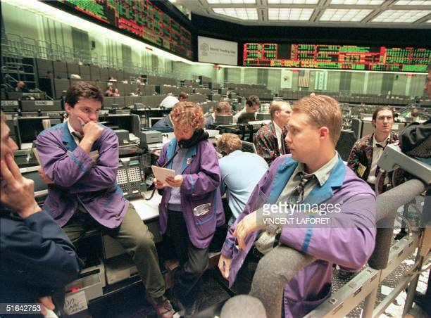 Patrick McKee and Brian Zajac of the Rosenthal Collins Group pause in a trading pit after Dow Jones trading stopped automatically at the Chicago...