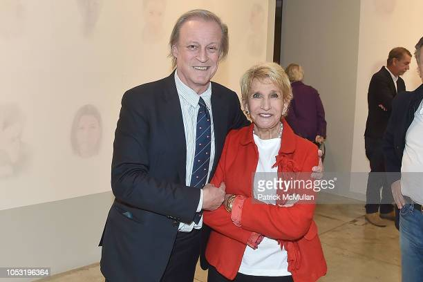 Patrick McMullan and Alexandra Penney attend the Alexandra Penney Vanishing Portraits Exhibition at Jason McCoy Gallery on October 24 2018 in New...
