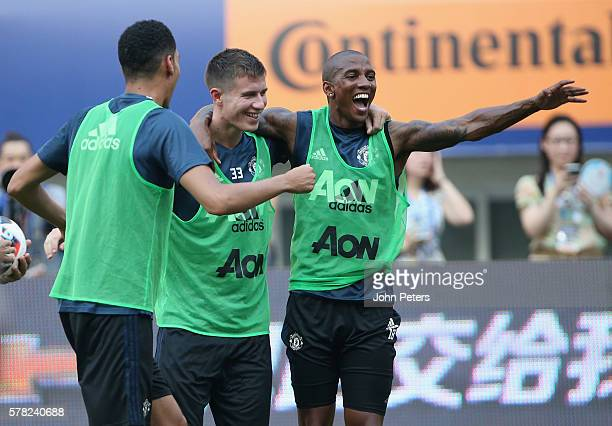 Patrick McNair and Ashley Young of Manchester United in action during a first team training session as part of their preseason tour of China at...