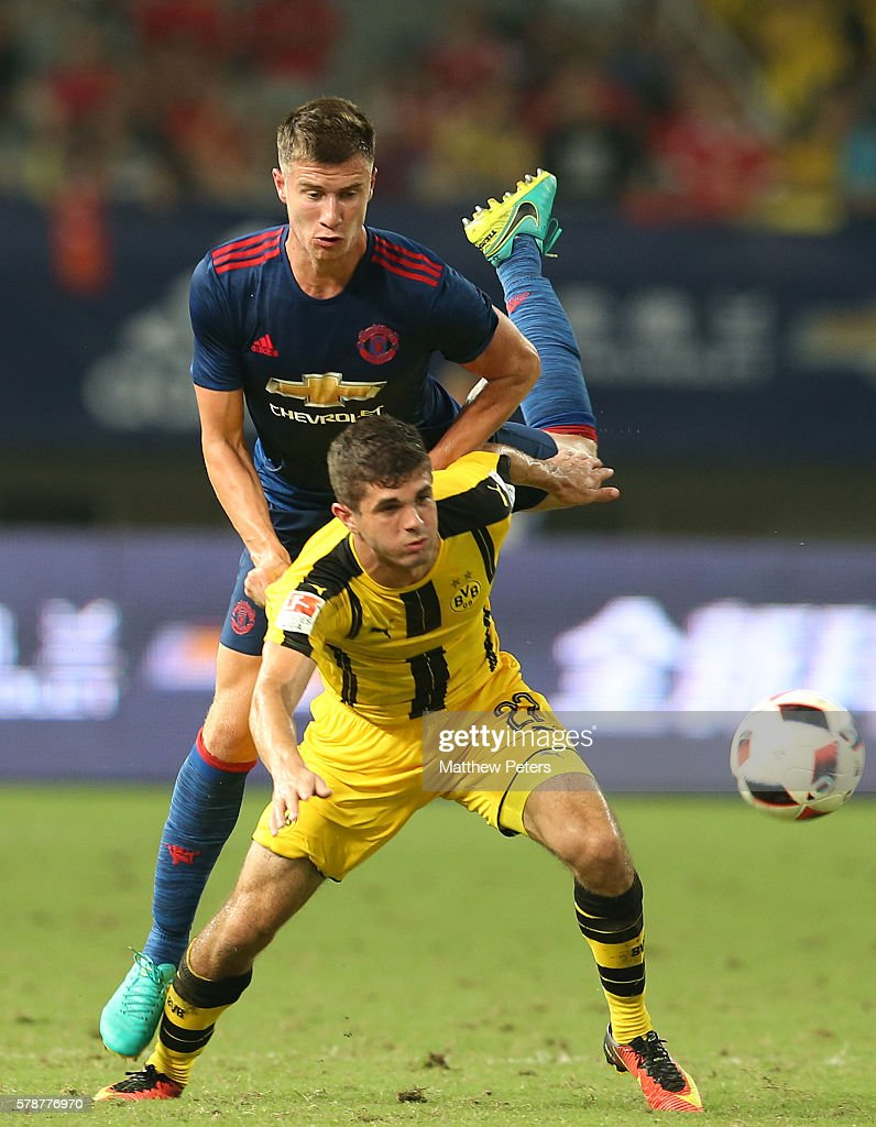 Patrick McNair of Manchester United in action with Christian Pulisic of Borussia Dortmund during the pre-season friendly match between Manchester United and Borussia Dortmund at Shanghai Stadium on July 22, 2016 in Shanghai, China.