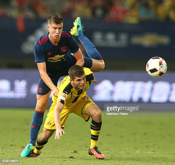 Patrick McNair of Manchester United in action with Christian Pulisic of Borussia Dortmund during the preseason friendly match between Manchester...