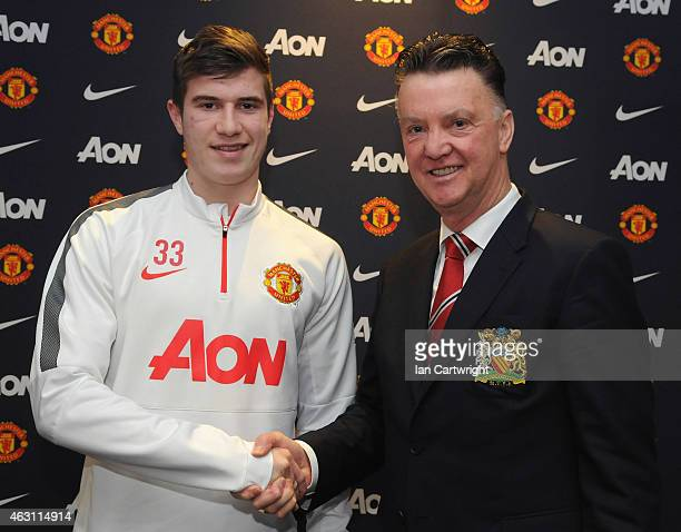 Patrick McNair of Manchester United shakes hands with Manchester United Manager Louis van Gaal after signing an extension to his playing contract at...